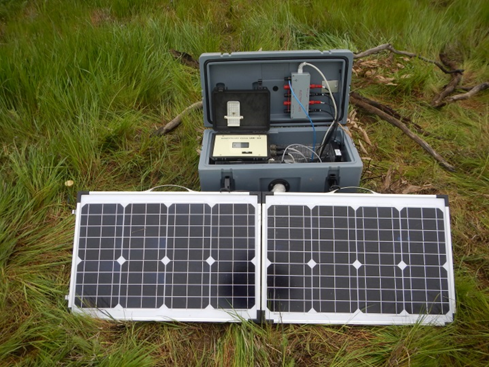 Medium sized plastic toolbox with multiple wires protruding from an opening in the front, powered by a solar cell