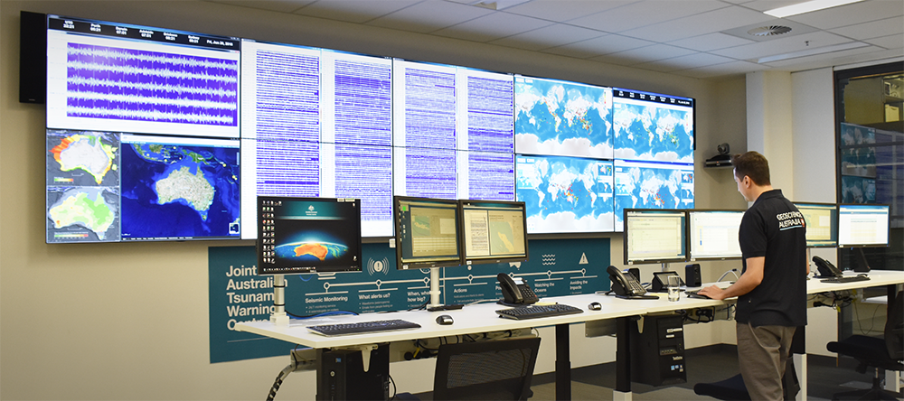 Staff member looking at computer screens in the Tsunami Warning Centre