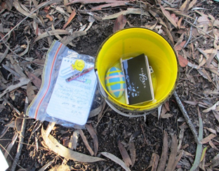 Another example of a geocache. Geocache contains miscellaneous items.